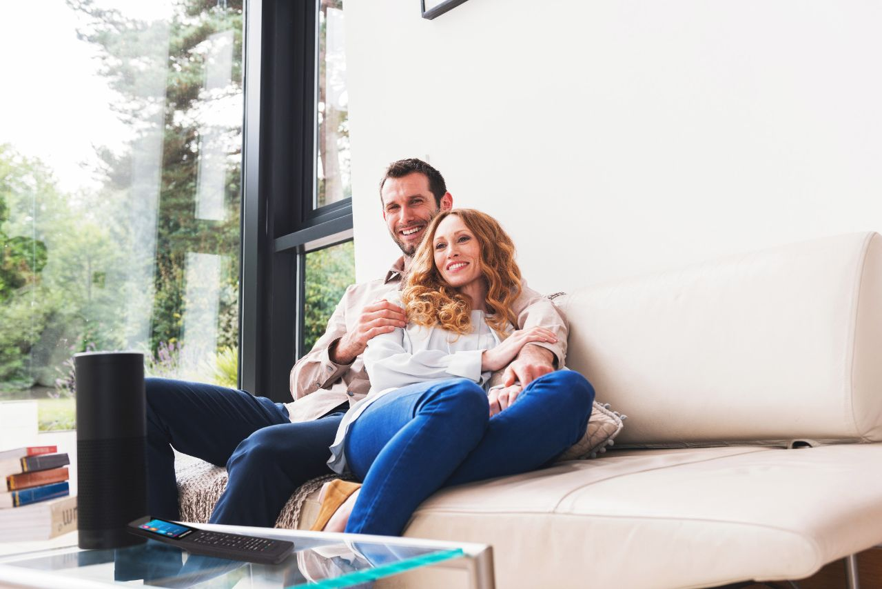 Couple using their Alexa virtual assistant with their smart home