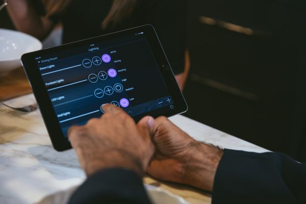 tablet accessing a smart tech device